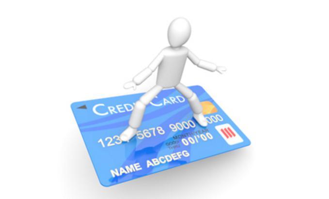 クレジットカードに乗る人形